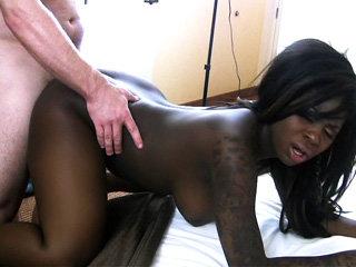 Splendid tattooed ebony chick Tatiyana Foxx gets a wild nasty fuck